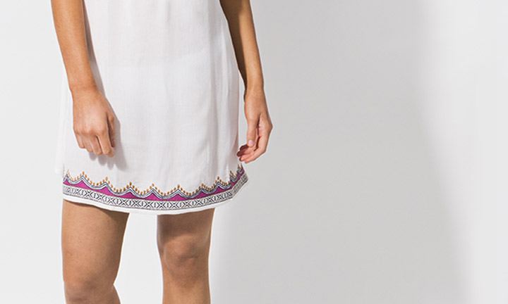 Short white beach dress with embroidery