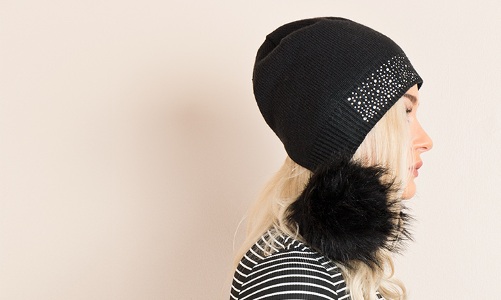 Black beanie style hat with diamante embellished beanie hat with large faux fur soft pom-poms