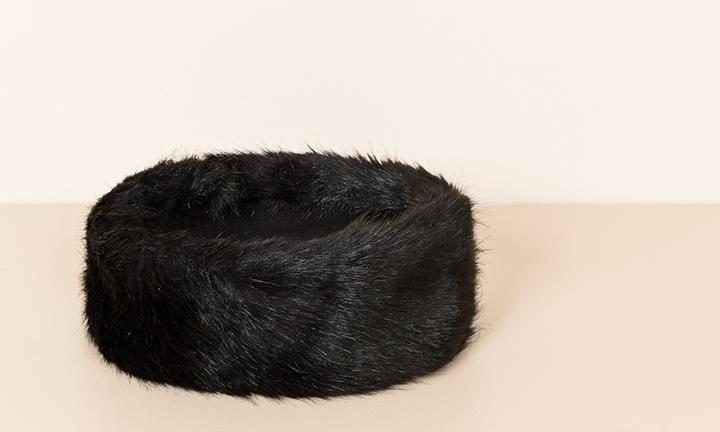 Warm black faux fur headband with a soft warm fleece lining