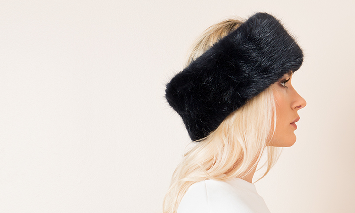 Luxury Navy faux fur headband with a soft warm fleece lining.